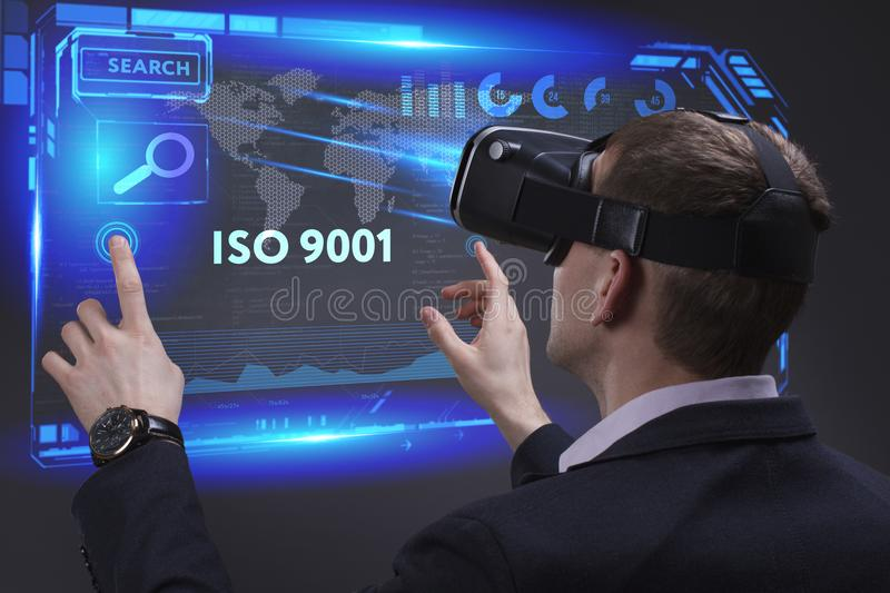 Business, Technology, Internet and network concept. Young businessman working on a virtual screen of the future and sees. The inscription: ISO 9001 stock images