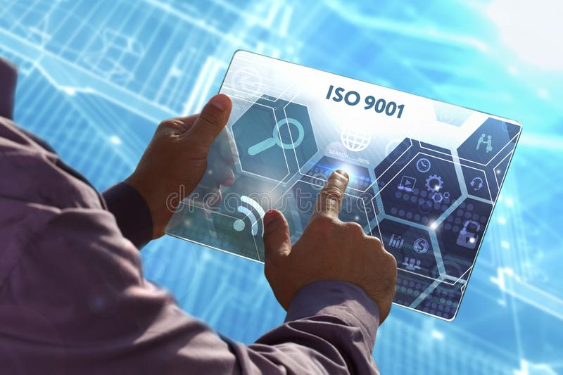 Business, Technology, Internet and network concept . Young busi. Ness man working on the tablet of the future , select the virtual screen: ISO 9001 stock photos