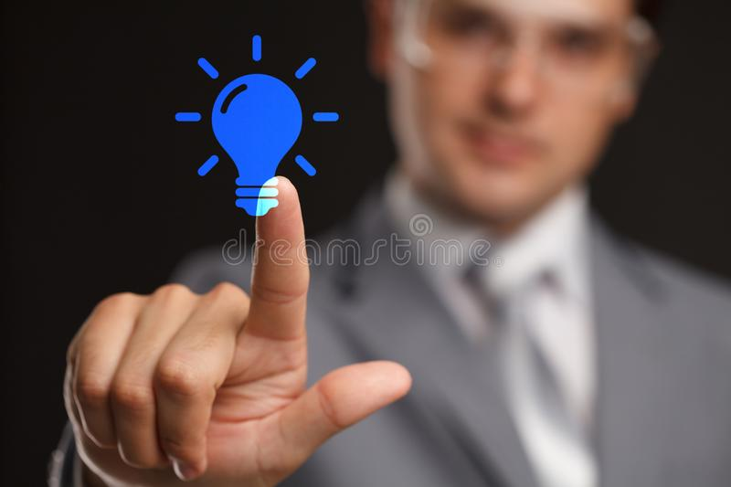 Business, technology, internet and networking concept - businessman pressing idea make money button on virtual screens. Business, technology, internet and stock images