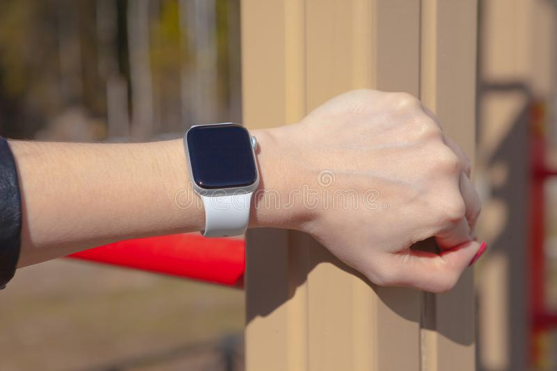 Business, technology and people concept - close up of woman hands setting smart watch stock photos