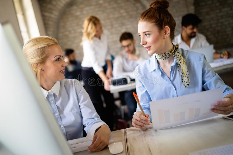 Business, technology and people concept - creative team or designers working in office royalty free stock photography