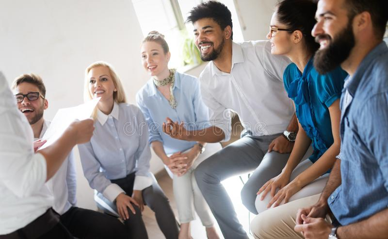 Business, technology and people concept - creative team or designers working in office stock image