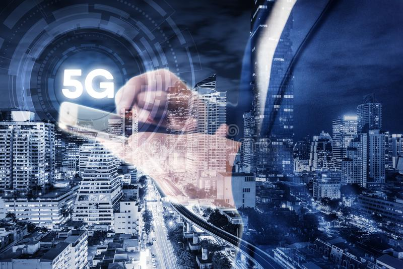 Business Technology Telecommunication and Communication 5G Network Connection Concept, Double Exposure of Businesswoman Using Mobi royalty free stock photo