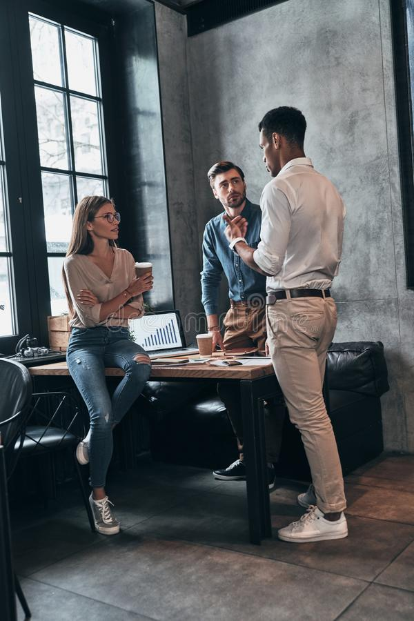 Business is their life. Group of young confident people having a stock images