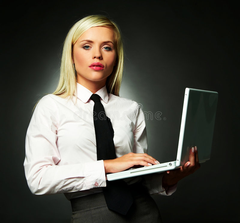 Business Tie. Young Business woman wearing white shirt and black tie using laptop computer royalty free stock photo
