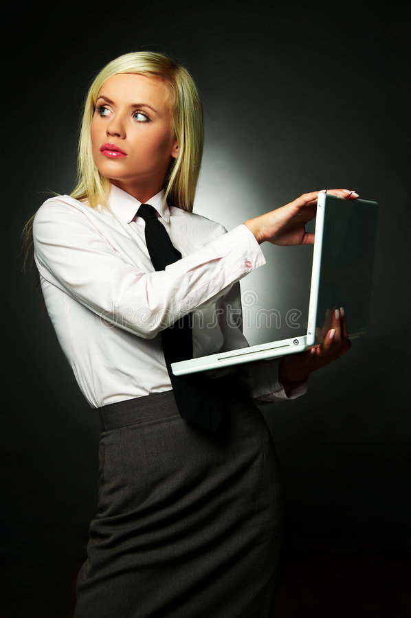 Business Tie. Young Business woman wearing white shirt and black tie using laptop computer