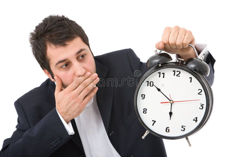 Business timing. Time concept in business with surprised businessman and clock, focus on clock face royalty free stock photo