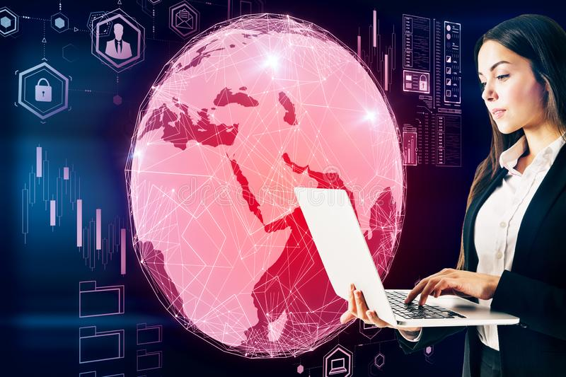 Business trading concept with trader woman with laptop at digital screen with earth globe background royalty free stock photography