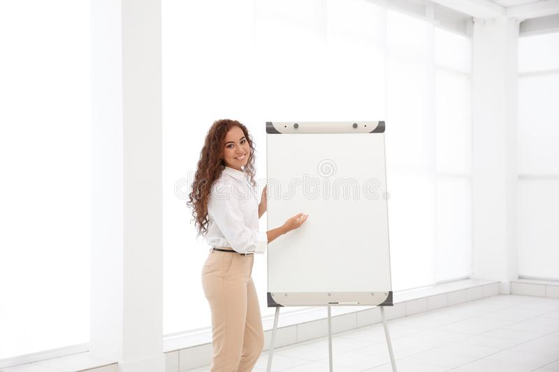 Business trainer giving presentation stock images