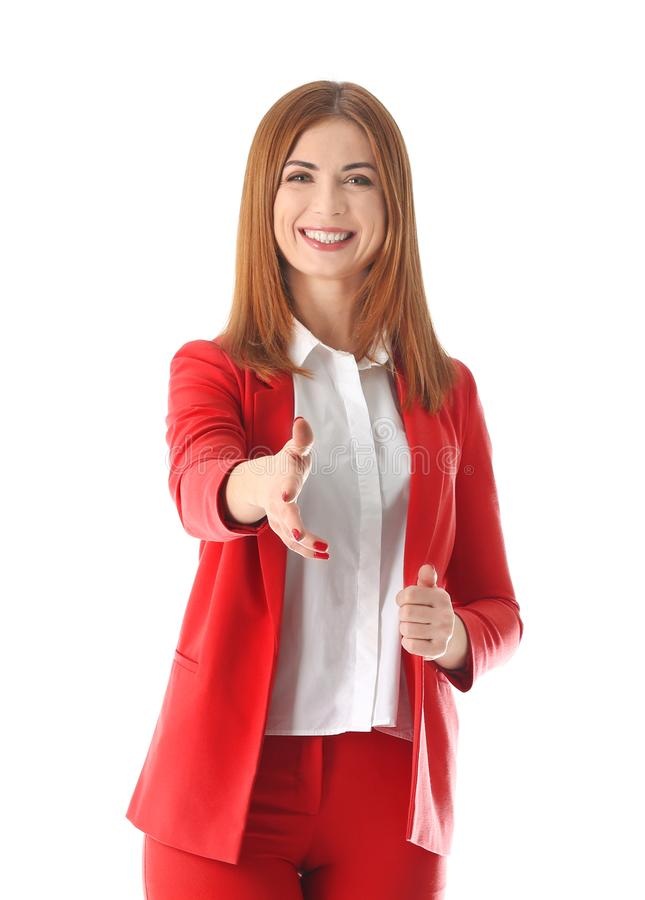 Business trainer reaching out for handshake. On white background stock photo