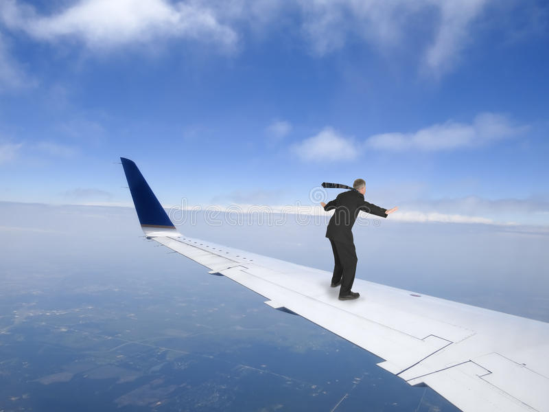Business Travel Concept, Businessman Flying on Jet Plane Wing, Trip stock photo