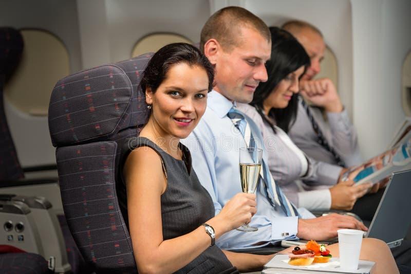 Business travel by plane woman enjoy refreshment. Business travel by airplane women enjoy refreshment flight cabin passenger stock image