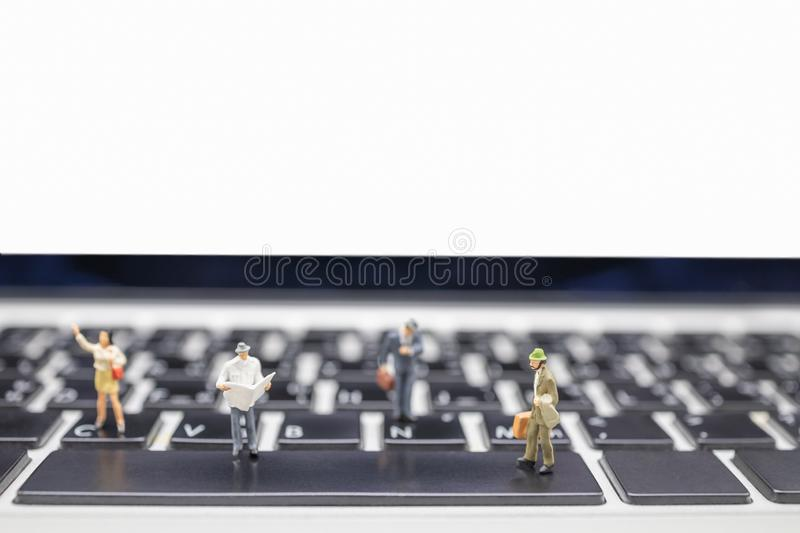 Business, Travel, Technology and information concept. Close up of group of businessman miniature figures with suitcase and stock image
