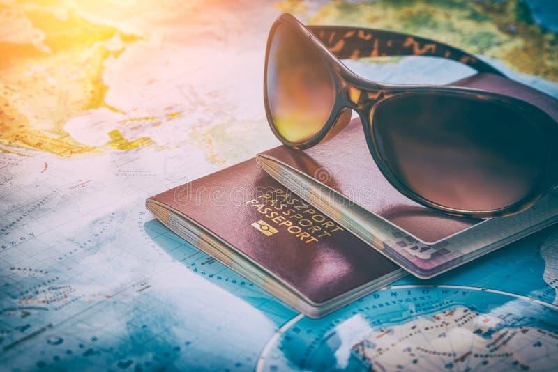 Business travel traveling map world concept. Travel passport map holidays visa tourism booking sunglasses plan tourist trip world glasses summer worldmap visit stock photography