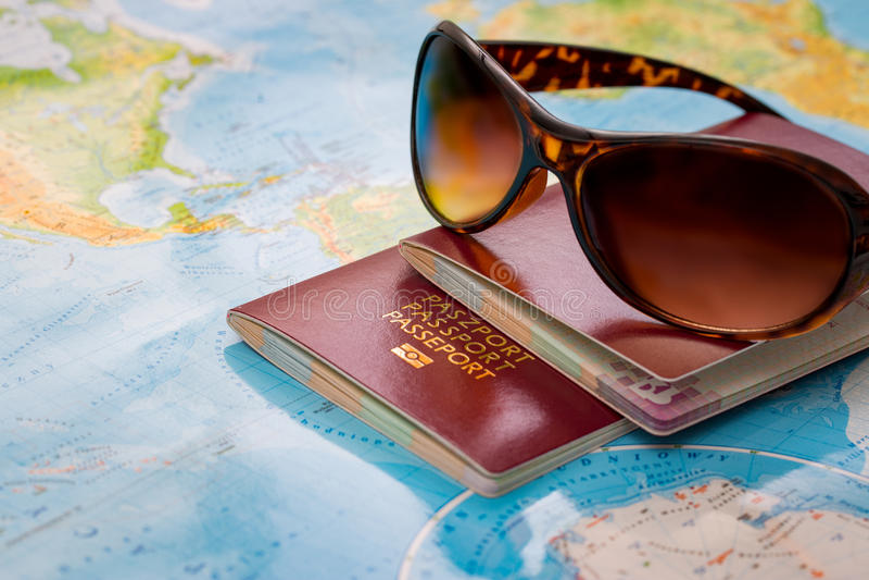 Business travel traveling map world concept. Travel passport map holidays visa tourism booking sunglasses plan tourist trip world glasses summer worldmap visit stock image