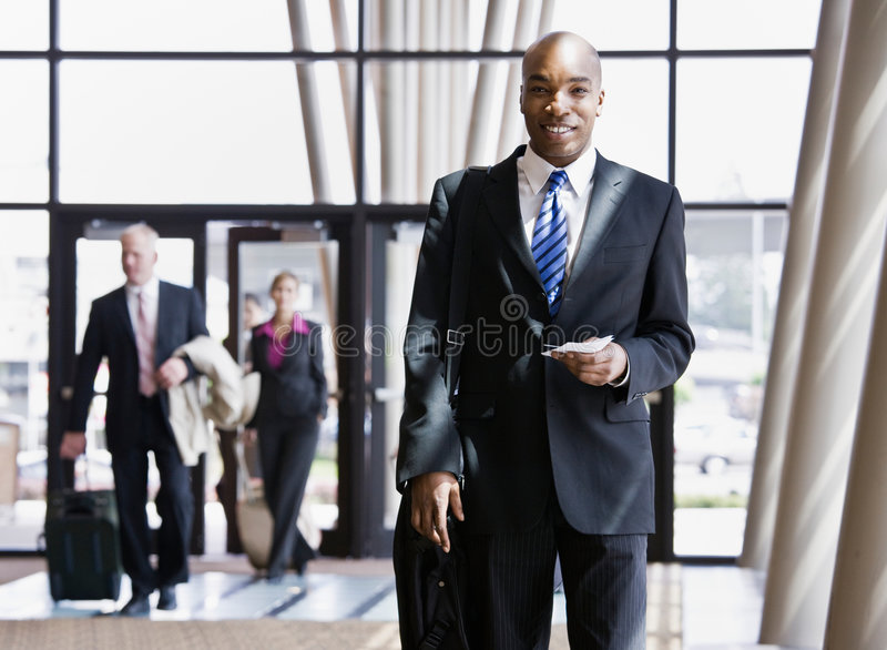 Business traveler holding briefcase, passport royalty free stock images