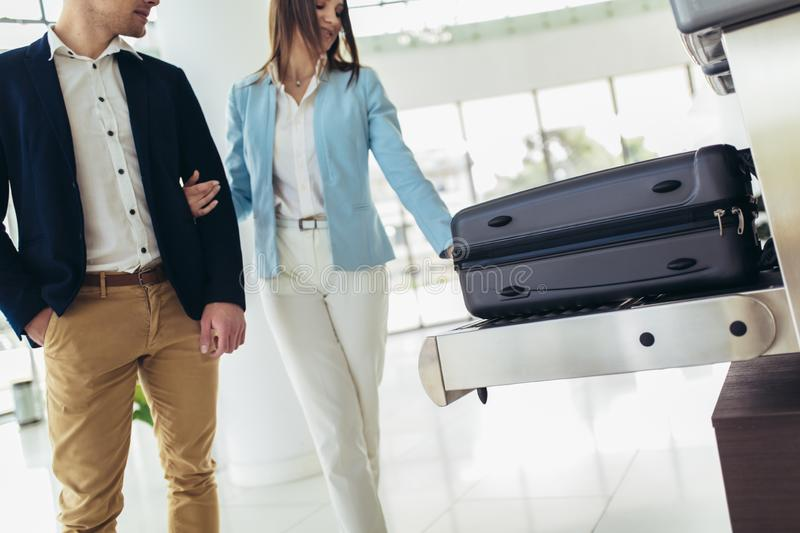 Travelers put baggage on X-ray machine try to detection metal prevention at the airport before take off stock images
