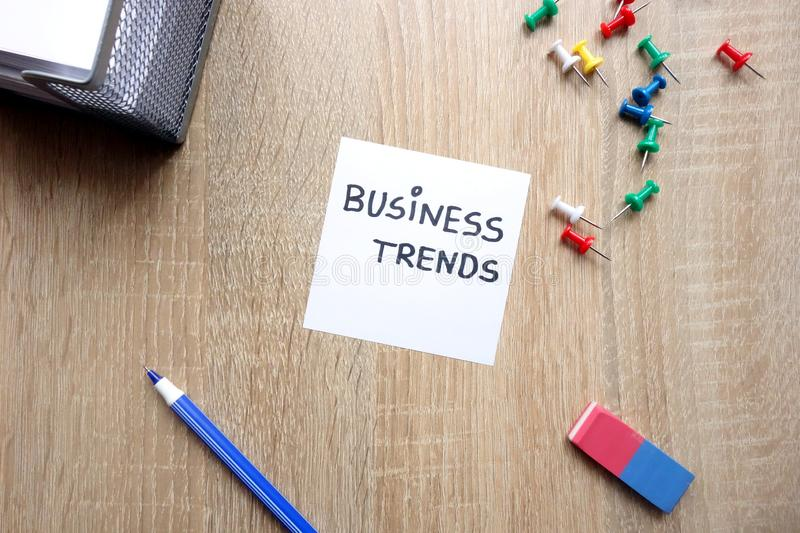 Business trends concept. With message on wooden table stock photos