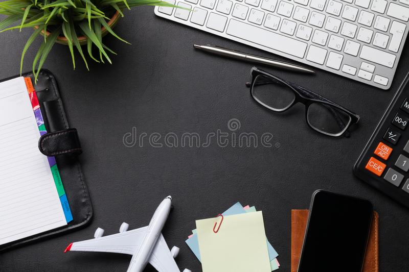 Business trip concept. Accessories on desk table. Pc keyboard, passport, calendar and airplane toy. Top view with copy space royalty free stock photos