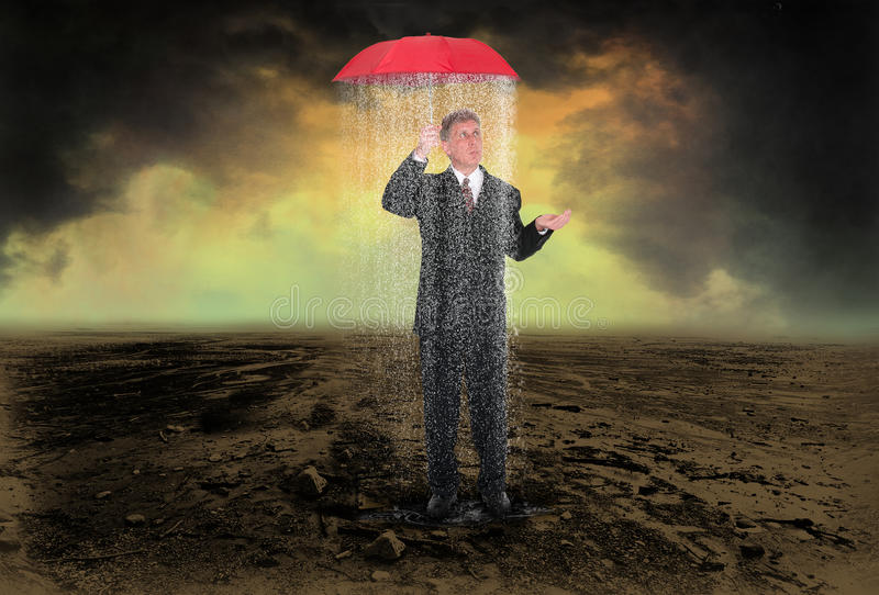 Business Trouble Sales Profit Marketing. A businessman stands under an umbrella but is still being rained on. The rain can be a metaphor for poor sales royalty free stock images