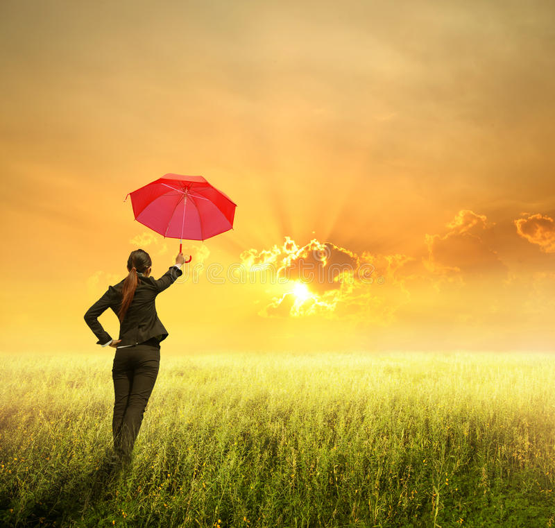 Business umbrella woman standing to sunset