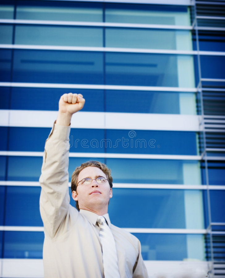 Business victory. Business man holds his hand up for victory royalty free stock photo