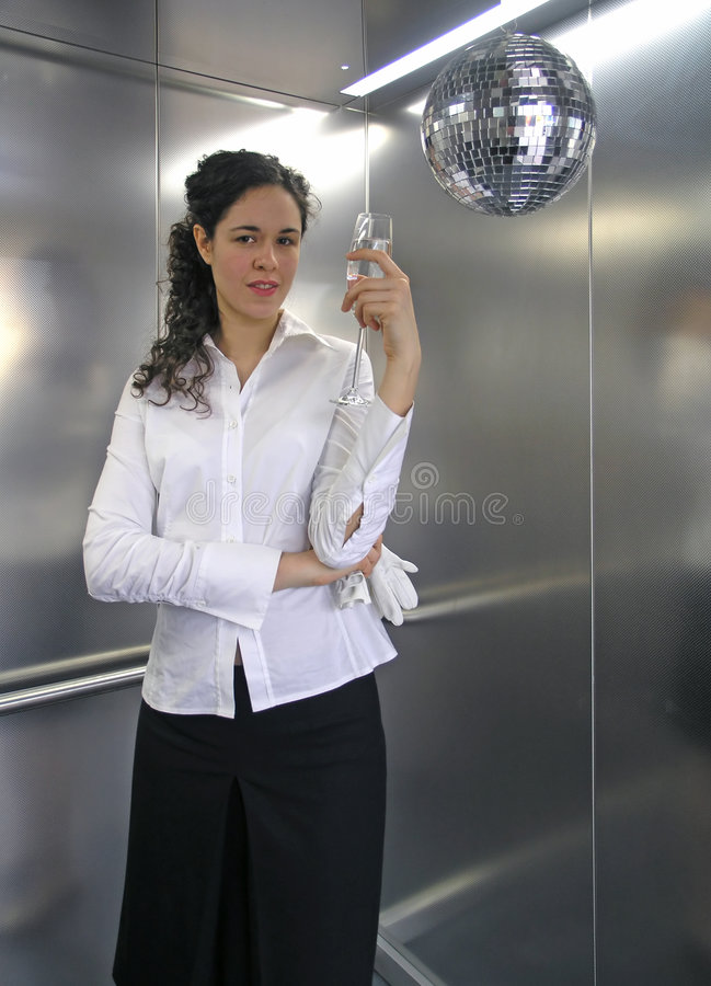 Business victory. Business woman celebrate in elevator with glass of champagne stock photos