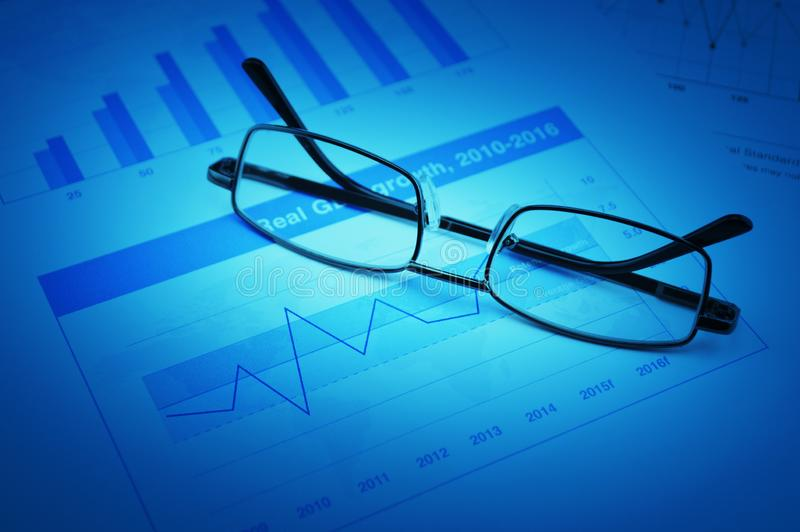 Business vision and success concept. Glasses on growth financial chart and graph, Business vision and success concept royalty free stock images