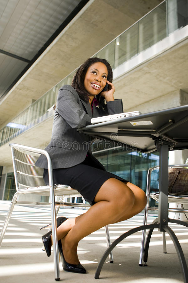 Business woman. Working outside on her computer royalty free stock image