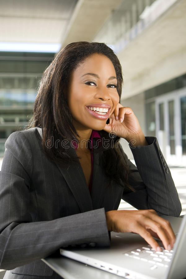 Business woman. Working outside on her computer stock photography