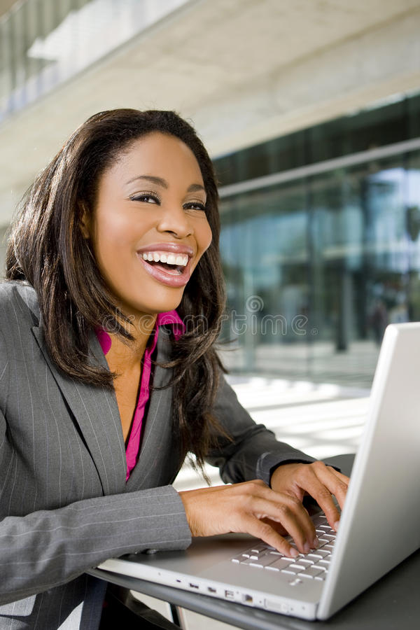 Business woman. Working outside on her computer stock photos
