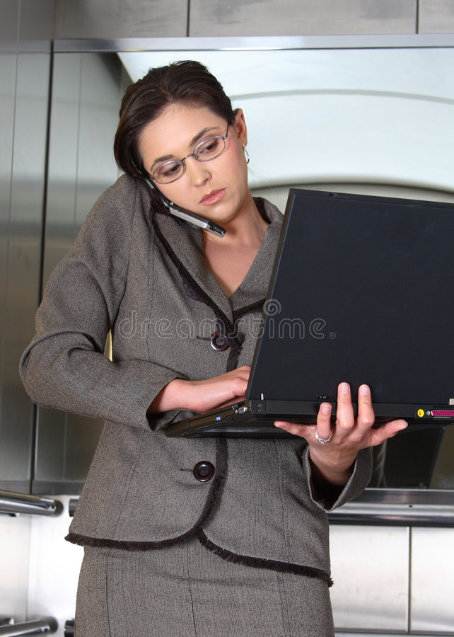Business woman. On cell phone with computer in lift royalty free stock photo