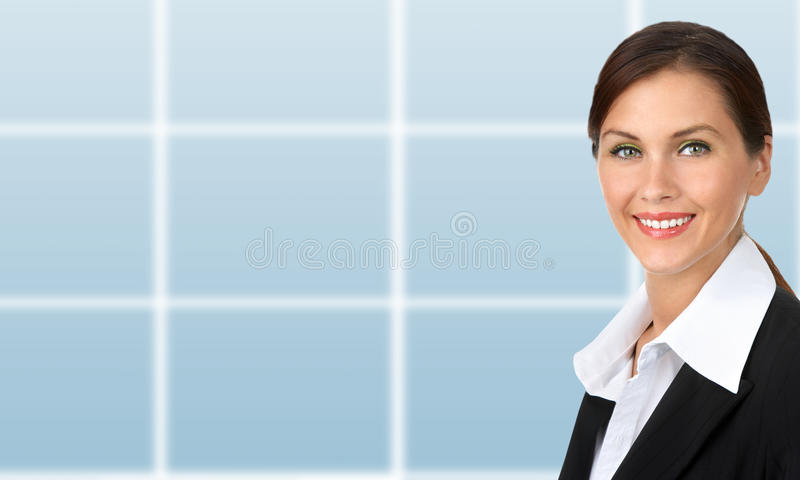 Business woman. Smiling business woman. Over blue background royalty free stock image