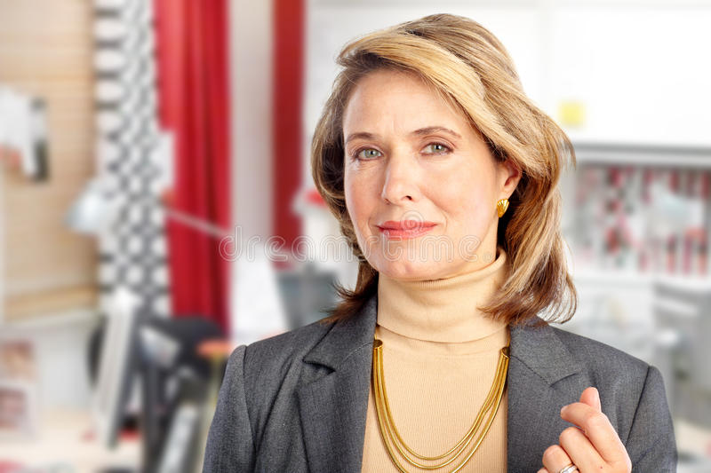 Business woman. Smiling mature business woman in the office royalty free stock photo