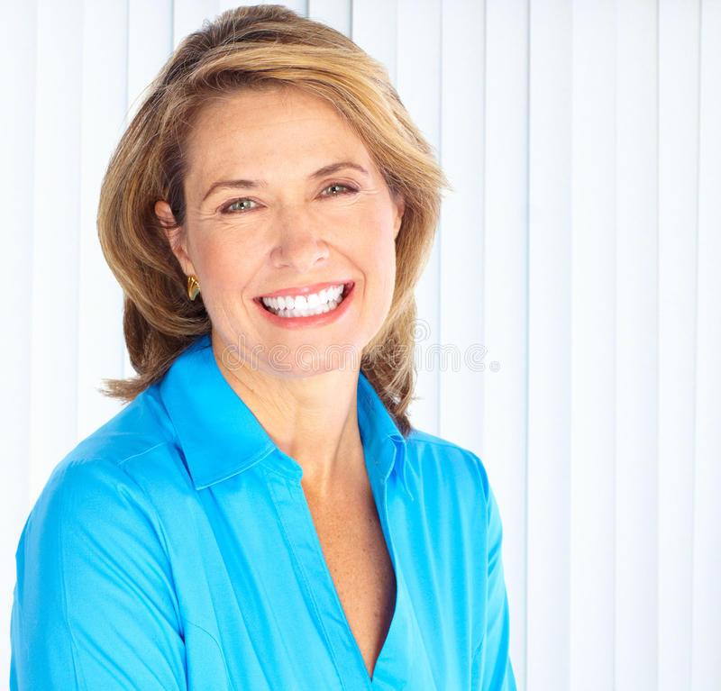 Business woman. Smiling mature business woman. Smiling lady stock photography
