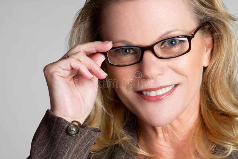 Business Woman. Blond business woman wearing eyeglasses stock photos