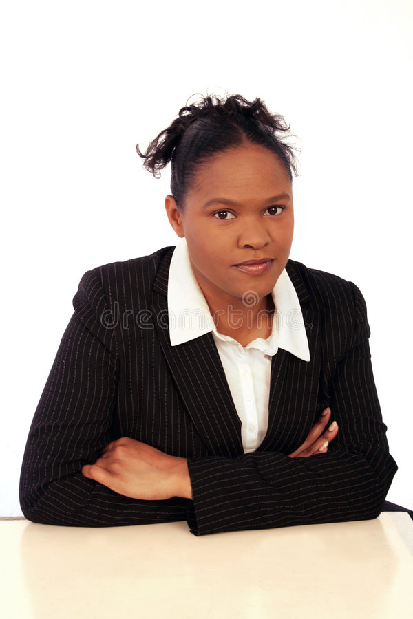 Business woman. Image of a serious business woman sitting at a desk royalty free stock photos