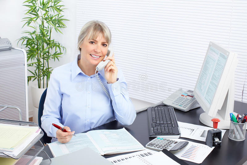 Business woman. Pretty business woman working in the office royalty free stock photo