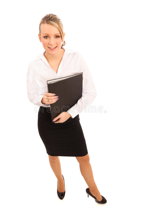 Business Woman. In white blouse and black skirt wth folder stock image