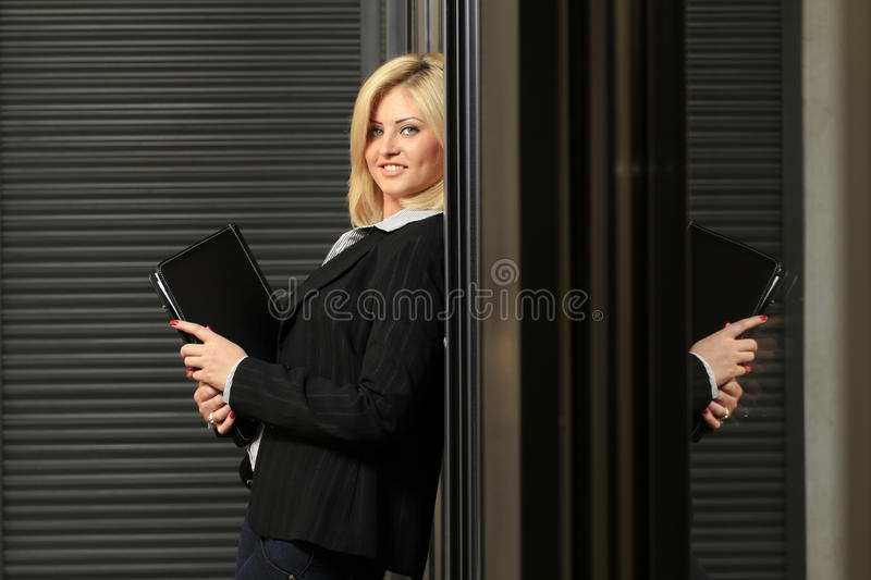 Business woman. Posing as manager in an office building setting stock photos