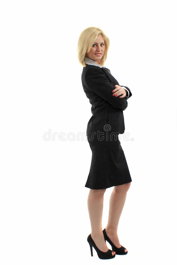 Business woman. Dressed in black suit, posing with her arms crossed, isolated on white background stock photos