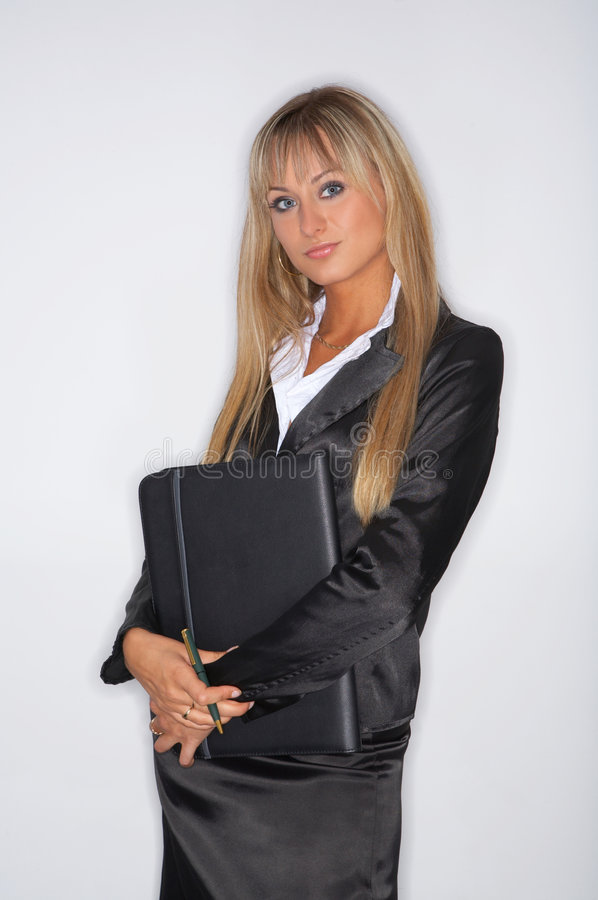 Business Woman. Beautiful and blond business woman isolated on clear background royalty free stock photos