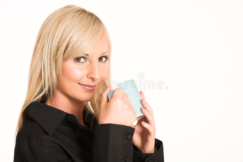 Business Woman #302. Blond business woman dressed in black trousers and a black shirt. Holding a mug - copy space royalty free stock photography