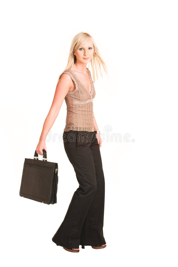 Business Woman #308. Blond business woman dressed in black trousers and a beige shirt. Walking, carrying a black leather suitcase. Movement on right foot stock images