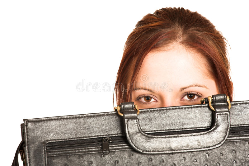Business Woman #335. Business woman with brown hair, peeking over a black leather suitcase stock image