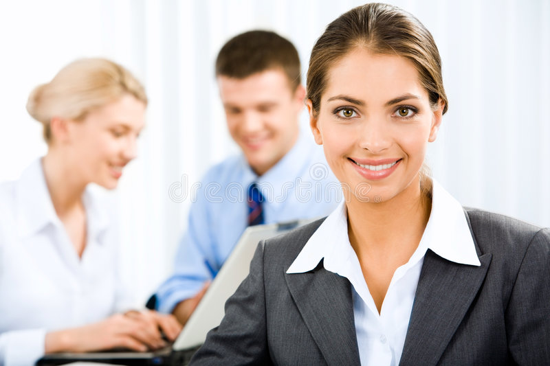 Business woman. Young beautiful woman is holding a document on the background of business people stock photography