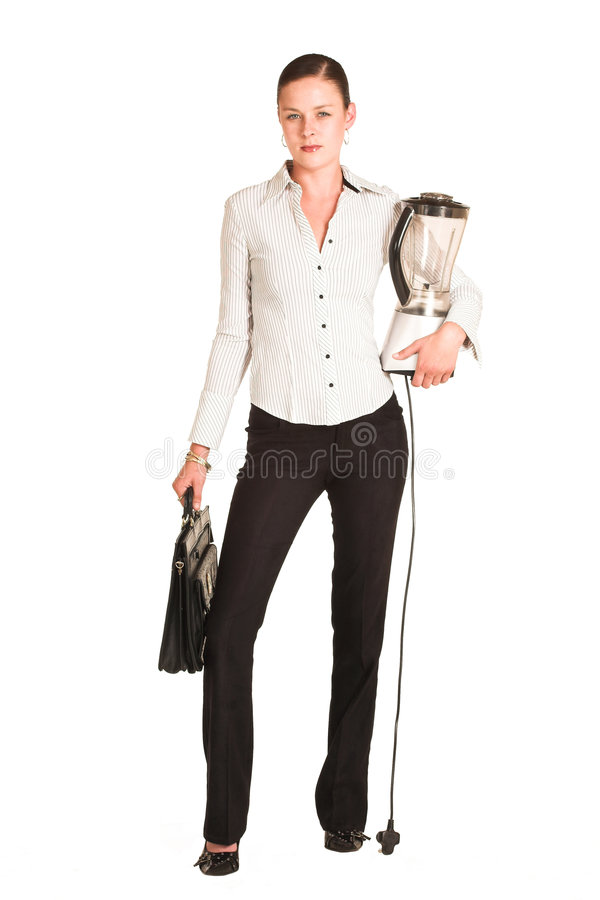 Business woman. Dressed in a white pinstripe shirt. Carrying a leather suitcase and a blender stock photo