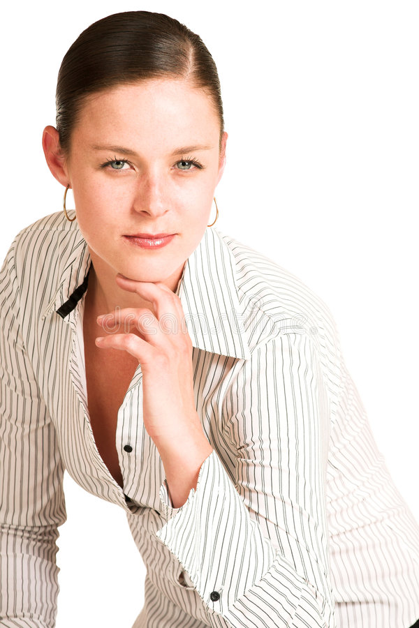 Business woman. Dressed in a white pinstripe shirt royalty free stock photos