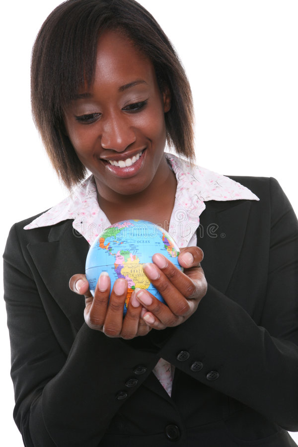 Business Woman. A pretty african american business woman holding globe royalty free stock image