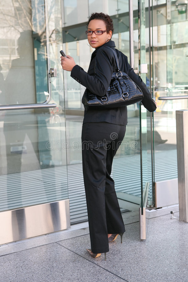 Business Woman. An african american business woman leaving work stock photo